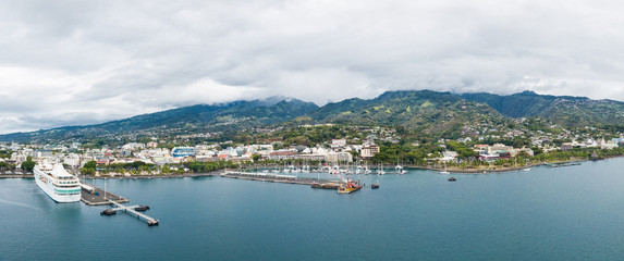 Papeete, Tahiti, French Polynesia. Aerial view of city skyline, sea port and marine from sea in a cloudy weather. Tahiti and her islands.