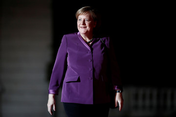 German Chancellor Angela Merkel arrives to attend a visit and a dinner at the Orsay Museum in Paris