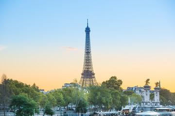 Eiffel Tower on Park Champ de Mars at sunset in Paris, France