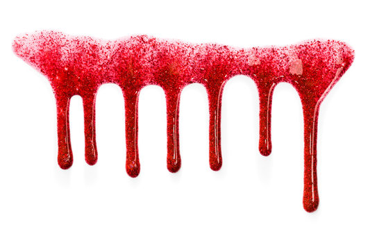 Flowing drops of red lip gloss with glitter. Isolated on white background.