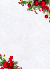 Christmas decoration. Frame of twigs christmas tree, christmas red balls and red berries on snow with space for text. Top view, flat lay