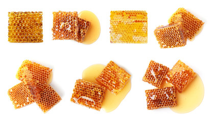 Set with sweet honeycomb pieces on white background, top view
