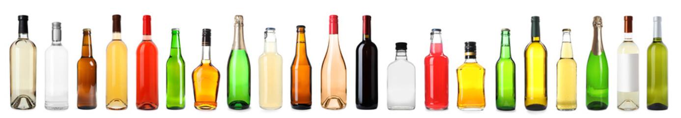 Fototapeta Set of bottles with different drinks on white background