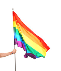 Gay man holding rainbow LGBT flag on white background