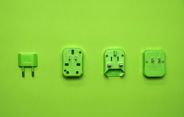 vivid green universal wall electric plug adapter aboard travel set for tourist