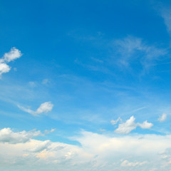 Clouds in the blue sky. A bright sunny day
