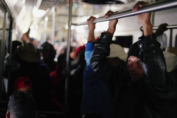 Migrants, part of a caravan of thousands traveling from Central America en route to the United States, use the subway as they make their way to Queretaro from Mexico City
