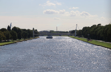 Sun is reflecting on the water of the Amsterdam Rhine Canal, Amsterdam Rijnkanaal in the Dutch language.