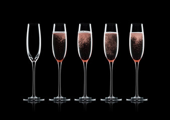 Rose pink champagne glasses with bubbles