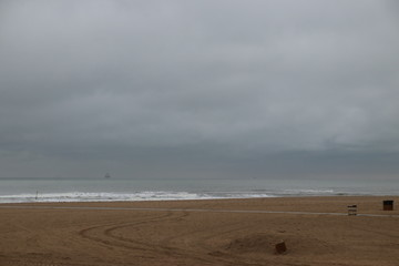 Dark clouds above the North Sea at the Beach of Scheveningen in the Netherlands