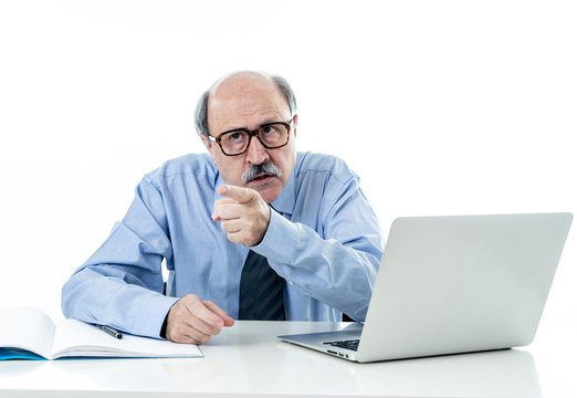 Angry older boss at work yelling and arguing at office