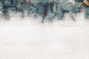 .Christmas composition on a white wooden background. Copy space