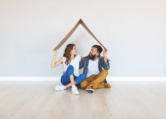 happy young married couple moves to new apartment