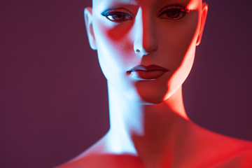 Mannequin in red light. Female robot Artificial Intelligence. Portrait of a woman. Mannequin in pink color.