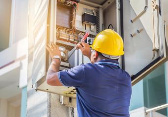 Electrician screwing equipment repairing in fuse circuit breaker box Wall mural