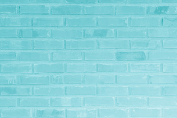 Brick wall painted with pale blue paint pastel calm tone texture background. Brickwork and...