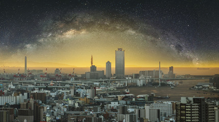 Panoramic Osaka city at dawn with starry sky