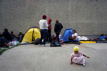 Migrants, part of a caravan of thousands traveling from Central America en route to the United States, camp outside La corregidora stadium in Queretaro
