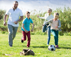Family  playing in football