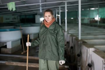 Female near fish tank on sturgeon farm