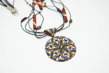 Mandala ethnic pendant isolated. Handmade jewelry of polymer clay. Winter necklace.