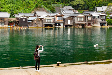 Woman take photo on cellphone at ine kyoto city