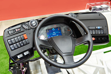 Steering wheel and dashboard of electric bus