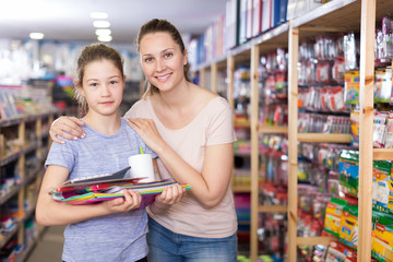 mother and daughter with stationery