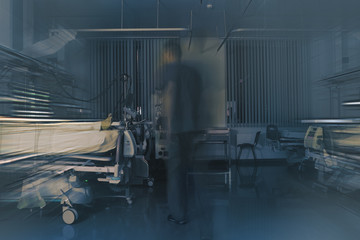 Medical doctor figure blurred in motion on the night shift in the critical care unit