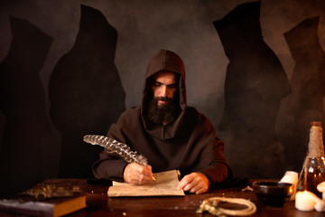 Medieval monk makes notes with a goose feather