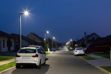 village street with modern LED streetlights at night Fotomurales