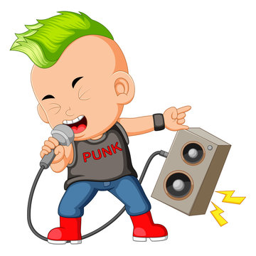 A Boy Dressed as a Rockstar Singing in front of a Loudspeaker