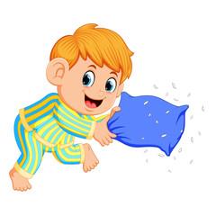a boy playing pillow