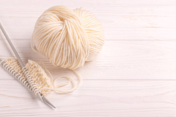 Warm knitted pattern of woolen yarn with needles