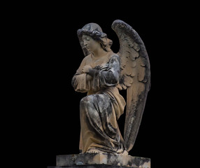 Antique medieval statue of a cemetery angel