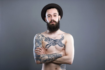 Man in Hat. Hipster boy with tattoed body