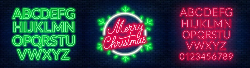 Neon sign merry christmas on a dark background with bright alphabets.