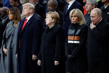 U.S. President Donald Trump, his wife Melania Trump, German Chancellor Angela Merkel, French President Emmanuel Macron's wife Brigitte and Russian President Vladimir Putin attend a commemoration ceremony for Armistice Day, in Paris