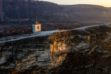 Old Orhei stone carved church at sunset. Aerial view, Moldova Republic