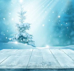 Merry christmas and happy new year greeting background with table .Winter landscape with fir tree branch