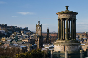 View from Calton Hill in winter with Dugald Stewart Monument in the foreground and Edinburgh Castle, Scott Monument and Balmoral Clock in the background, Edinburgh, Scotland