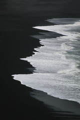 White water on black sand - view from Dyrholaey, Iceland