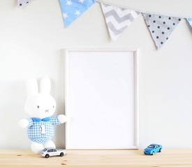 White wooden frame mock up for nursery art prints, photos, lettering, toy bunny and toy cars, blue bunting.
