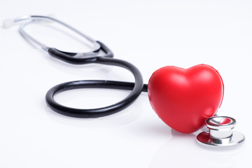 Healthcare or medical concept. Stethoscope and a red heart on a white background.