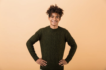 Portrait of a happy young africa man dressed in sweater