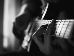 a young guy playing blues on an electric guitar. close-up.
