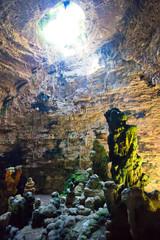 Grotta di Castellano, Apulia - Impressive stone formations illuminated through a hole