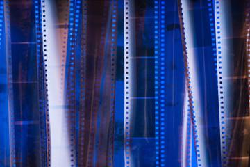 Analog photographic film texture. Blue lighting.