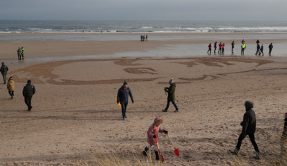 Sand drawing of William Jonas part of Armistice Day anniversary at Seahouses, in Northumberland