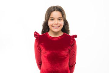 Feel so trendy in elegant clothes. Fashion concept. Kid adorable smiling posing in red velvet dress. Kids fashion. Girl cute child wear velvet dress. Velvet dress perfect pick whatever occasion